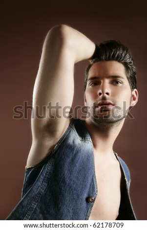 Denim handsome sexy young man portrait on brown background - stock photo