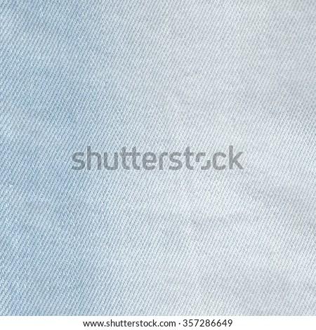 Denim jeans texture. Denim background texture for design. Canvas denim texture. Blue denim that can be used as background. Blue jeans texture for any background. Light color denim textile background. - stock photo