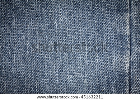 Denim jeans texture or denim jeans background with seam of fashion jeans design with copy space for text or image. Dark edged. - stock photo