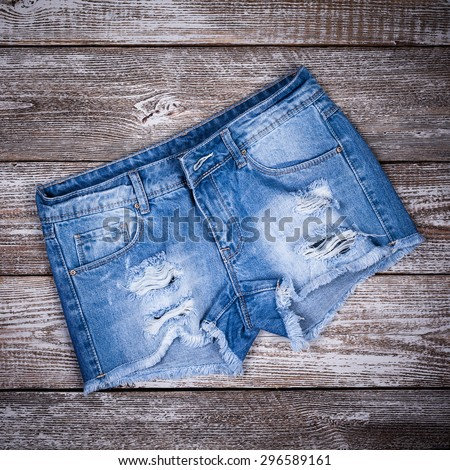 denim shorts on a wooden background - stock photo