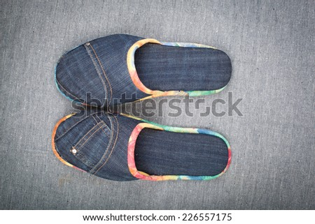 Denim slippers on the background of denim. - stock photo