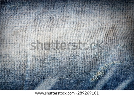 denim texture background, frayed fabric grunge background - stock photo