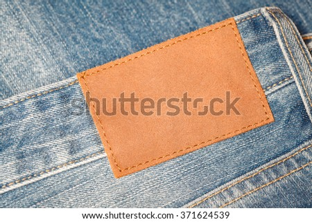 Denim texture  with leather label tag for background