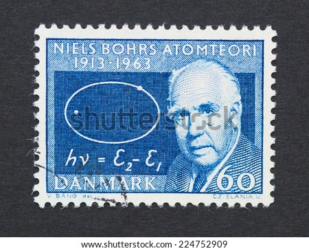 DENMARK - CIRCA 1963: a postage stamp printed in Denmark showing an image of Nobel prize winner Niels Bohr, circa 1963.  - stock photo