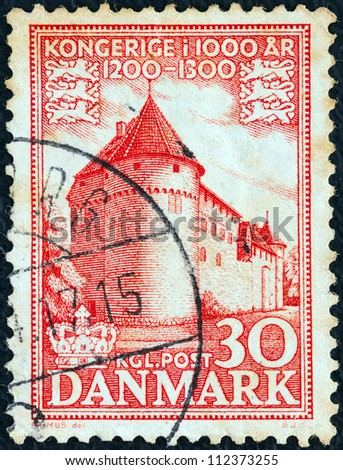 "DENMARK - CIRCA 1953: A stamp printed in Denmark from the ""1.000 years of Danish Kingdom"" issue shows Nyborg Castle, circa 1953."