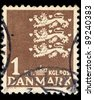 DENMARK - CIRCA 1946: A stamp printed in Denmark shows image of three lions, series, circa 1946 - stock photo