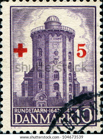 DENMARK - CIRCA 194: A stamp printed in the Denmark shows Round Tower of Trinity Church, circa 1944