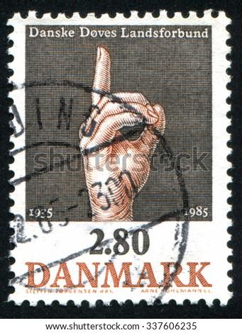 DENMARK - CIRCA 1985: stamp printed by Denmark, shows finger, circa 1985 - stock photo