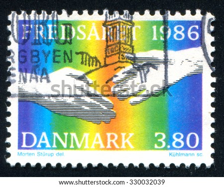 DENMARK - CIRCA 1986: stamp printed by Denmark, shows hand, circa 1986 - stock photo