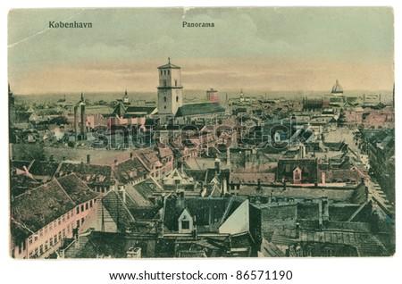 DENMARK, COPENHAGEN - CIRCA 1910: Vintage postcard with weathered edges on white background printed circa 1910, Denmark. Retro aerial panorama of Copenhagen, Denmark - stock photo