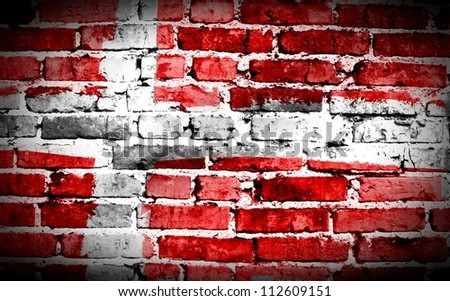 Denmark flag on old brick wall Background or texture - stock photo