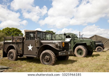 DENMEAD, UK - MAY 25: A line up of allied WW2 and post war trucks stand on display in the main show field for the public to view at the Overlord show on May 25, 2014 in Denmead