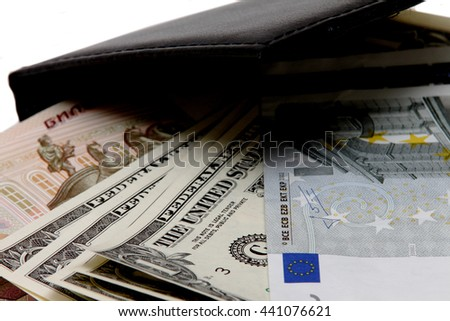 denominations dollar, euro, ruble black purse isolated on white background - stock photo