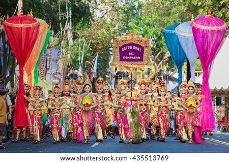 DENPASAR, BALI ISLAND, INDONESIA - JUNE 11, 2016: Beautiful indonesian people group in colorful sarongs - traditional Balinese style ethnic dancer costumes, at Bali Arts and Culture Festival parade - stock photo