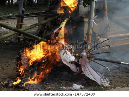 DENPASAR, INDONESIA - MAY 12:  The burning remains of the head of the white bull used as a sarcophagus in a Balinese Ngaben or cremation ceremony in Ubud, Denpasar, Bali, Indonesia on May 12, 2013.