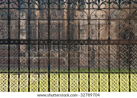 Dense pattern of wrought iron fence in Cambridge, UK - stock photo