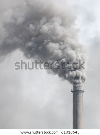 Dense smoke from a chimney - stock photo