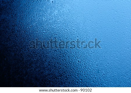 Dense texture made by condensed moist on window glass - stock photo