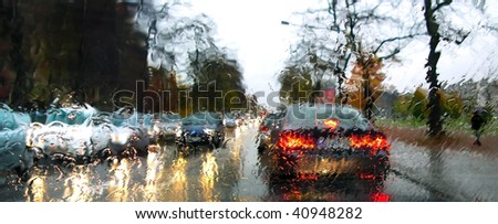 dense traffic on a rainy day - stock photo
