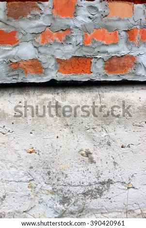Densely cemented ground birick wall above basement - stock photo