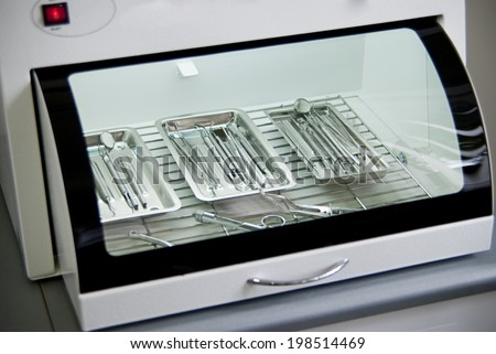 Dental background: work in clinic (operation, tooth replacement) - stock photo