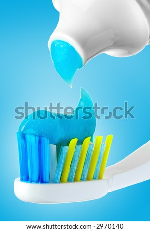 Dental brush and tube with paste. - stock photo