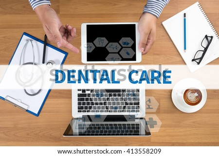 DENTAL CARE Doctor touch digital tablet, desktop with medical equipment on background, top view, coffee - stock photo