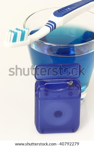 Dental care products on bright background - stock photo