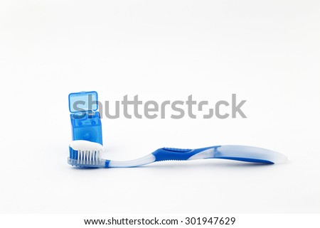 Dental Care: Toothbrush and Dental Floss - stock photo