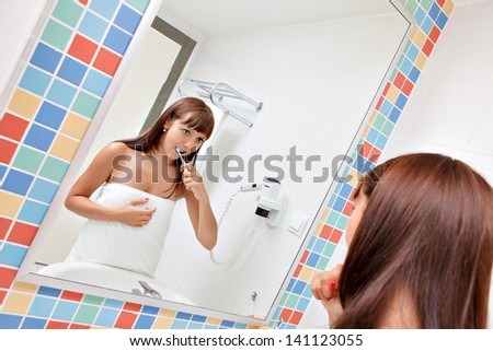 Dental care.Woman cleans a teeth