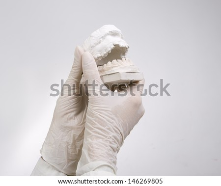 Dental Casting - hands holding dental gypsum models, dental concept - stock photo