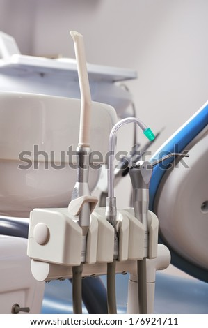 Dental chair and dental tolls - stock photo