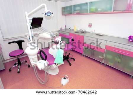 Dental clinic interior design with chair and tools - stock photo