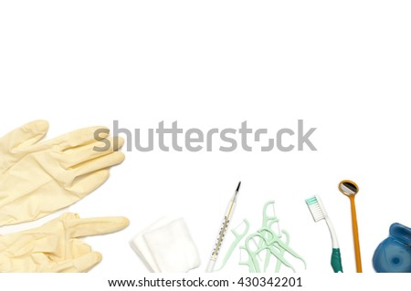 Dental Equipment,Toothbrush and dental tools on a white background, Used rubber gloves, cotton, floss , toothbrush,Thermometer and glass for teeth.Isolated on white - stock photo