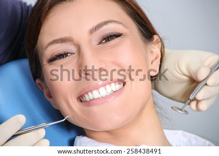 dental examination of attractive girl in the office of the dentist - stock photo