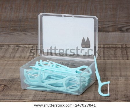 Dental floss on a wooden background.