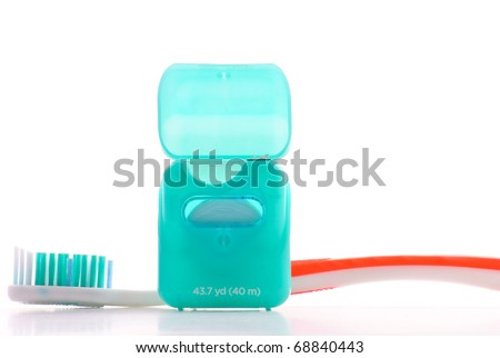 Dental Floss with Toothbrush - stock photo