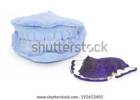 dental gypsum models and dental brace (Retainer) - stock photo