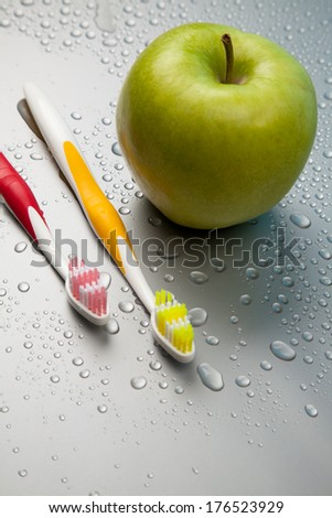 dental health care objects and an apple - stock photo