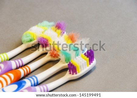 Dental Health - the importance of using a new toothbrush for effective everyday brushing vs old worn toothbrushes and their inefficiency. - stock photo