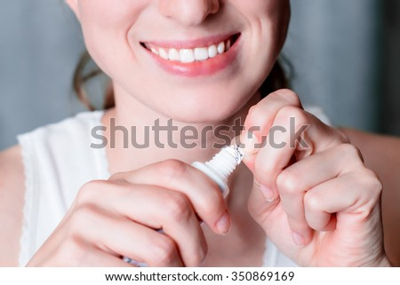 Dental hygiene and care. Toothpaste. Young healthy woman face with beauty smile. Tooth paste. Oral clean, whitening. Beautiful girl. Person healthcare. Female in the morning in bathroom.  - stock photo