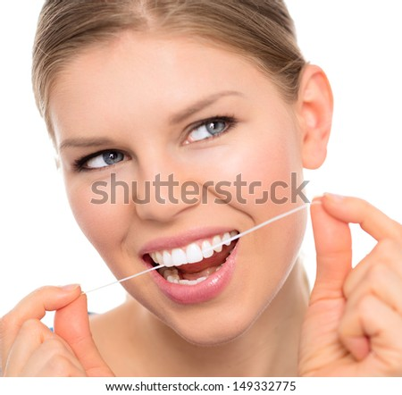 Dental hygiene woman cleaning teeth with floss, isolated over white background. Young attractive blonde with white toothy smile.   - stock photo