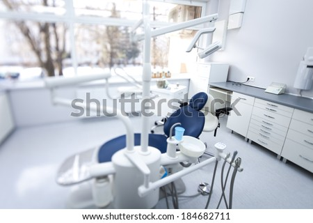 Dental instruments and tools in a dentist office - stock photo