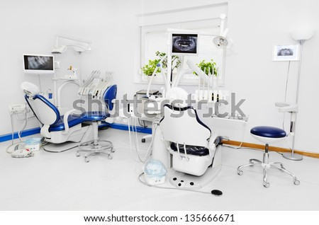 Dental office with blue dental chair - stock photo