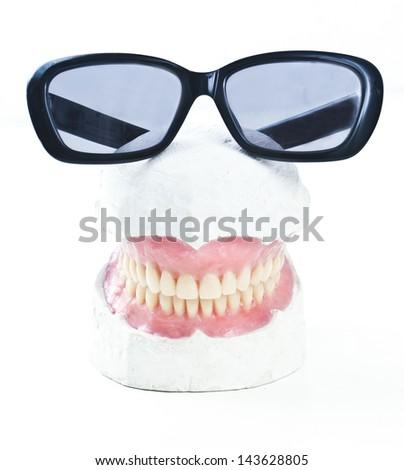 dental prosthesis ona  gypsum model with sunglasses - stock photo