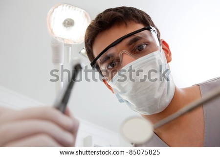 Dental technician with cleaning tools