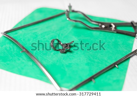 Dental tools and equipment isolated on white - stock photo