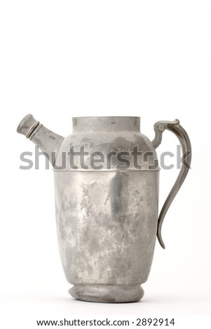 Dented and dusty watering can