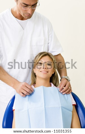 dentist and his patient in examination room - stock photo