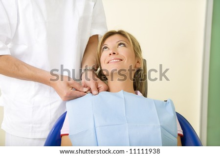 dentist and his patient in examination room. Copy space - stock photo